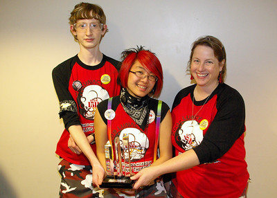 Team members Rika and Calvin, and Mentor Cynette with our Entrepreneur Award